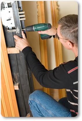 handyman repairing commercial locks